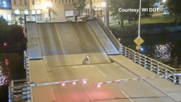Mind the gap: Cyclist ignores bridge warning at her peril