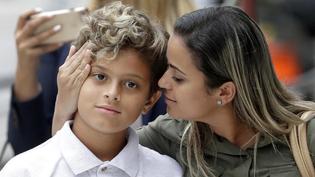 Sirley Silveira Paixao, an immigrant from Brazil seeking asylum in the U.S., looks at her 10-year-old son Diego Magalhaes after Diego was released from immigration detention July 5, 2018, in Chicago.