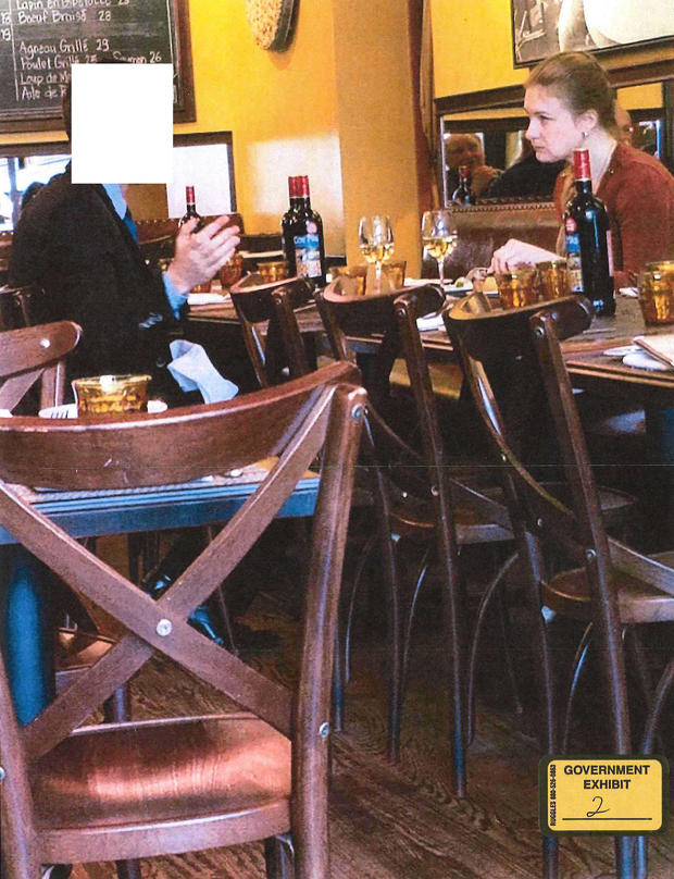 Handout photo of accused Russian agent Maria Butina shown sitting at a table with a suspected Russian Intel Operative in a restaurant, according to court documents, in a FBI surveillance photo