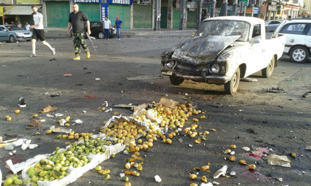 Damages after a suicide bomb attack are seen in Sweida