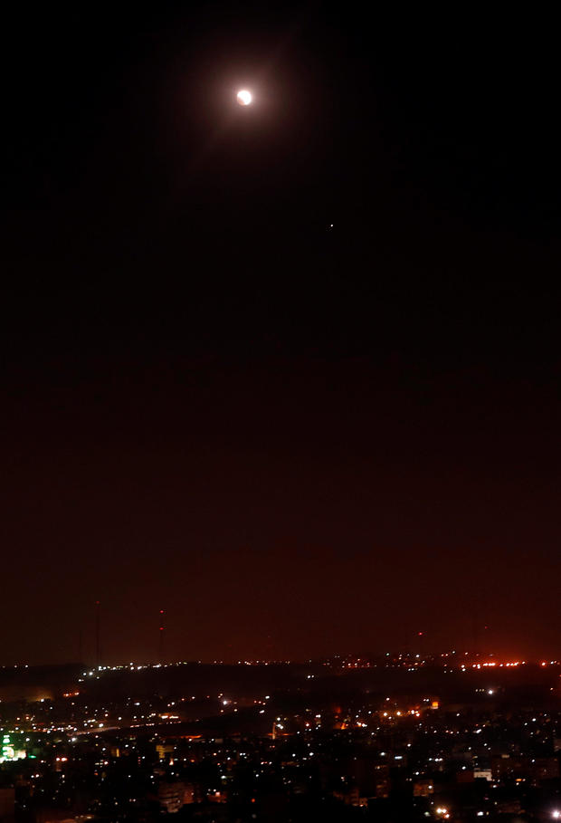 """A general view during a lunar eclipse of """"Super Blue Blood Moon"""" rising over Cairo"""