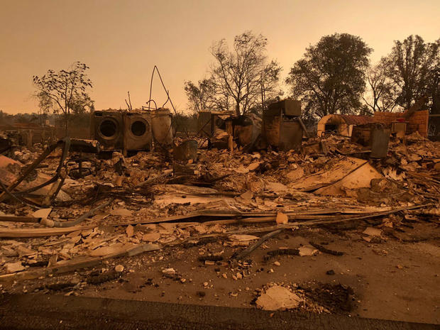 A burned out home in the small community of Keswick is shown from wildfire damage near Redding, California