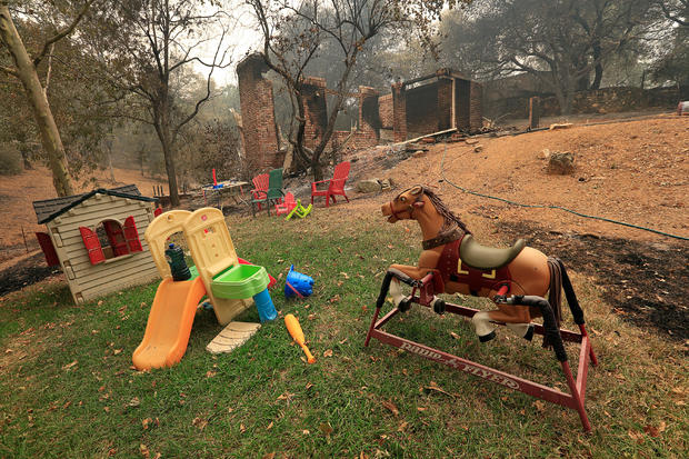 Toys stand untouched near a home destroyed by the Carr Fire west of Redding