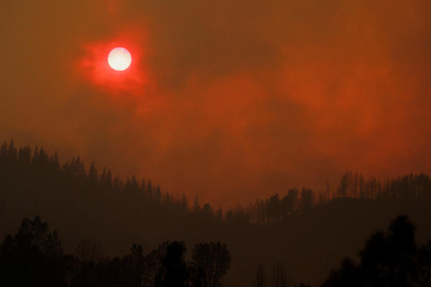 The setting sun is turned red by the smoke from the Carr Fire west of Redding