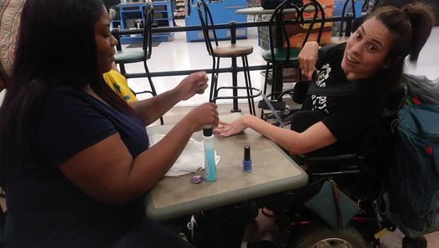 Walmart cashier steps in after nail salon refuses woman with cerebral palsy