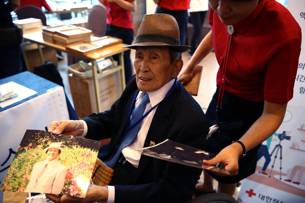 Tears, hugs, arguments as Korean families reunite after 70 years