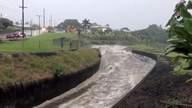 Stormwater flows through a drainage system after Hurricane Lane in Hilo, Hawaii