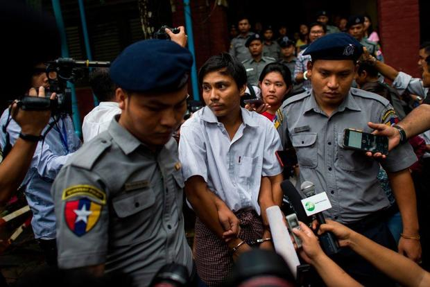 Myanmar journalists arrested as Aung San Suu Kyi in global spotlight