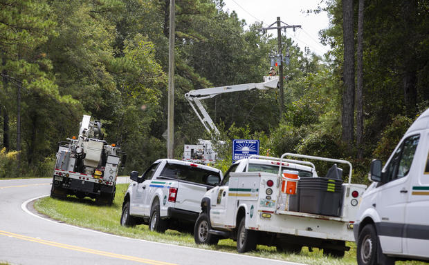 Talquin Electric linemen in Crawfordville, Florida, shut off the power to Shell Point Beach prior to the arrival of Hurricane Michael on Oct. 9, 2018.