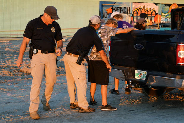 Police detain some youths on suspicion of looting following Hurricane Michael in Mexico Beach