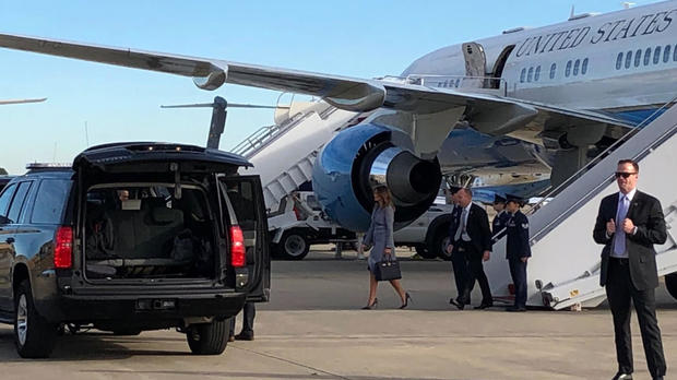 First lady Melania Trump walks on the tarmac at Joint Base Andrews in Maryland after a plane carrying her unexpectedly returned to the military base on Oct. 17, 2018.