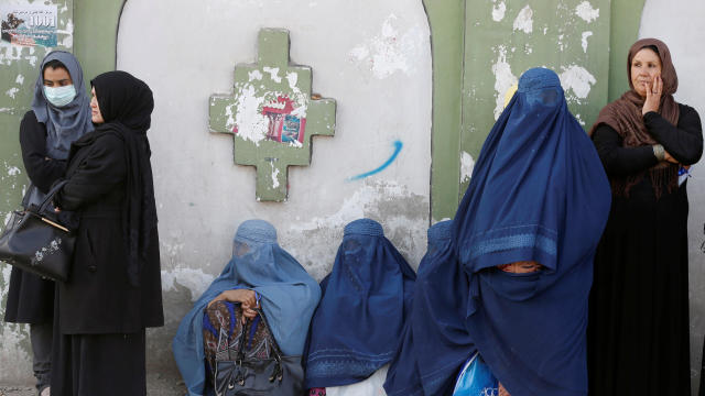 Afghan women line up to cast their votes during a parliamentary election at a polling station in Kabul