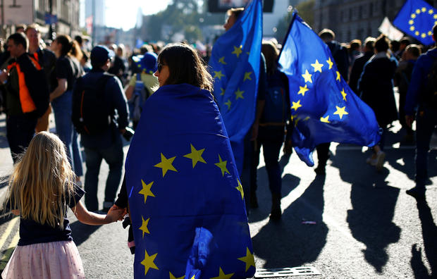 Protesters taking part in an anti-Brexit demonstration march through the center of London