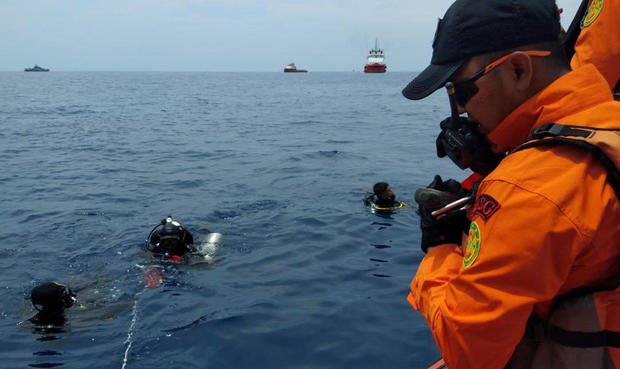Rescue personnel prepare to dive at the location where a Lion Air plane crashed into the sea in the north coast of Karawang regency