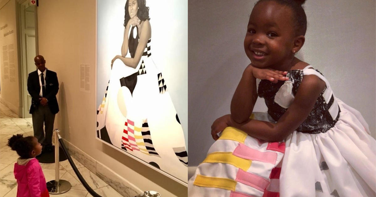 Little girl obsessed with Michelle Obama's portrait dressed as her for Halloween