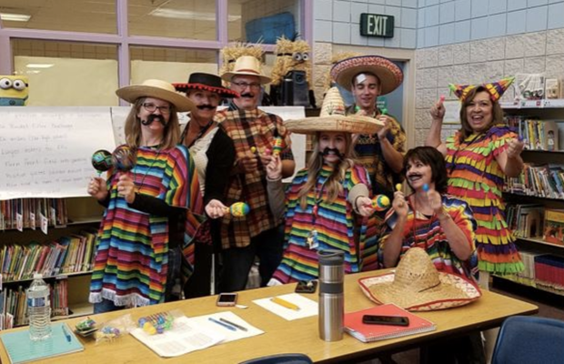 School teachers dress up as a MAGA border wall for Halloween