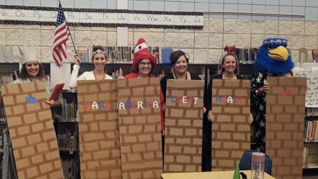 Elementary school teachers dressed up as a MAGA border wall for Halloween