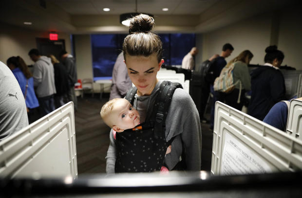 Kristen Leach votes with her 6-month-old daughter, Nora, on Election Day in Atlanta Nov. 6, 2018.
