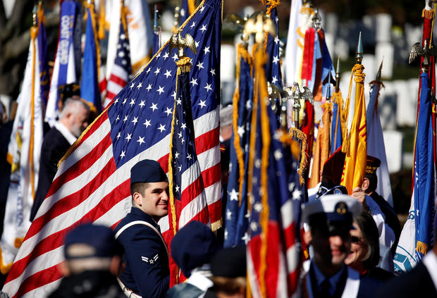 Honor guards from veteran's groups await the start of ceremonies on Veteran's Day at Arlington National Cemetery in Arlington