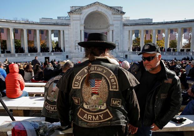 An Army veteran awaits the start of ceremonies on Veteran's Day at Arlington National Cemetery in Arlington