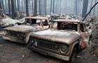Trucks destroyed by the Camp Fire are seen in Paradise