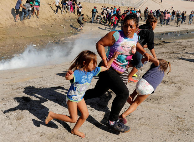 migrant caravan — tear gas at U.S.-Mexico border