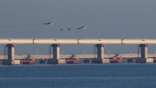 Russian jet fighters fly over a bridge