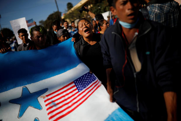 Migrants, part of a caravan of thousands traveling from Central America en route to the United States, take part in a protest march towards the border wall between the U.S. and Mexico, in Tijuana