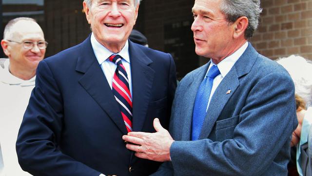Former US president George H.W. Bush (L)