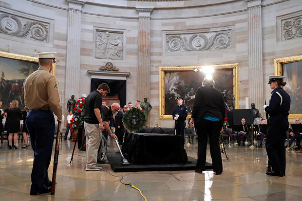 Members of a military choir await the beginning of ceremonies for the late former U.S. President George H.W. Bush inside the U.S. Capitol rotunda in Washington