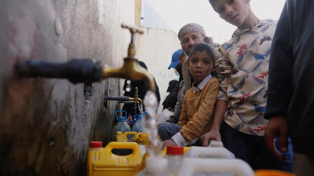 People collect drinking water from charity tap amid fears of a new cholera outbreak in Sanaa