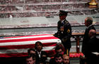 Former U.S. President George W. Bush looks on as casket of former U.S. President George H.W. Bush is carried at conclusion of funeral service in Houston