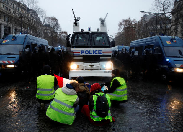 """Protesters wearing yellow vests take part in a demonstration by the """"yellow vests"""" movement in Paris"""