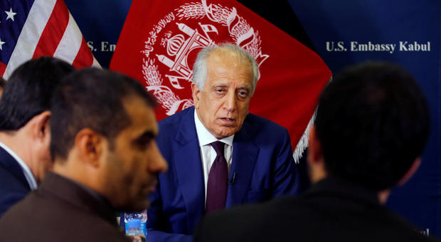 U.S. special envoy for peace in Afghanistan, Zalmay Khalilzad, talks with local reporters at the U.S. embassy in Kabul