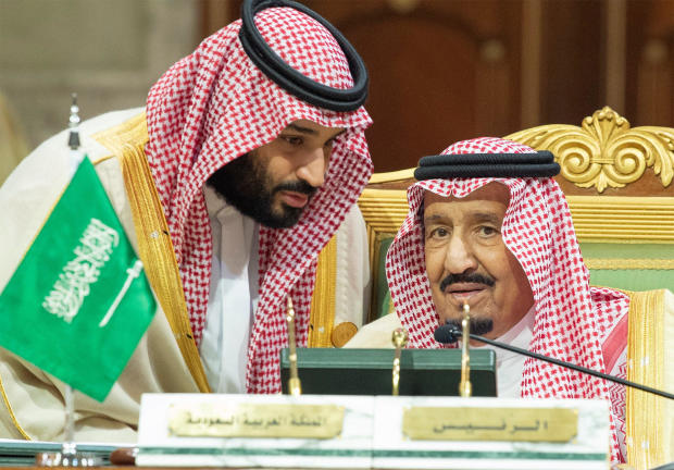 Saudi Arabia's Crown Prince Mohammed bin Salman talks with Saudi Arabia's King Salman bin Abdulaziz Al Saud during the Gulf Cooperation Council's (GCC) Summit in Riyadh