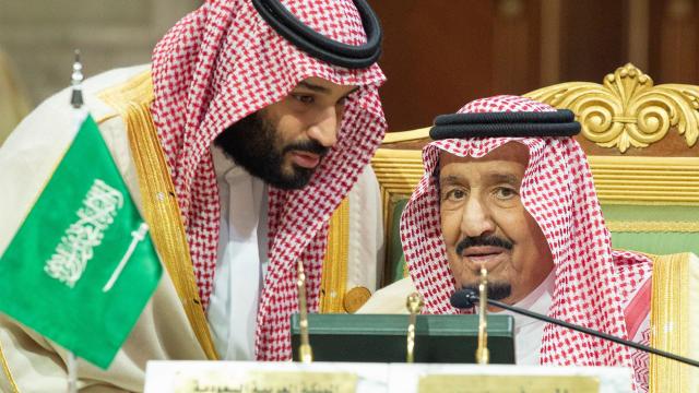 Saudi Arabia's Crown Prince Mohammed bin Salman talks with Saudi Arabia's King Salman bin Abdulaziz Al Saud during the Gulf Cooperation Council's (GCC) Summit in Riyadh