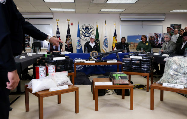 Officer indicates serized items as U.S. President Trump speaks during visit to U.S.-Mexico border in McAllen, Texas