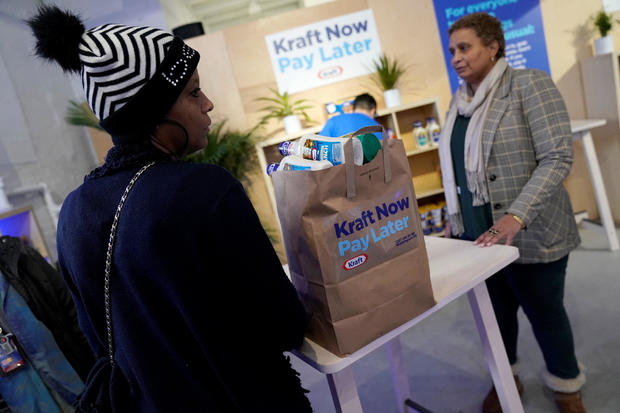 Federal workers left unpaid or furloughed collect a free bag of groceries from Kraft Foods on the 27th day of the partial government shutdown in Washington