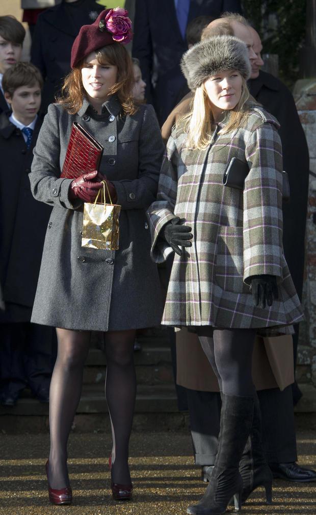 Britain's Princess Eugenie of York (L) a