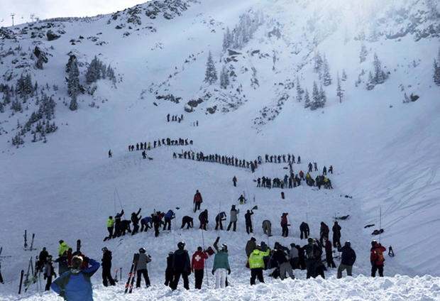 People search for victims after an avalanche buried multiple people near the highest peak of Taos Ski Valley, one of the biggest resorts in New Mexico, Jan. 17, 2019.