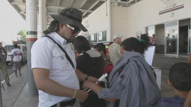 ctm-0121-mexico-migrant-processing-caravan-wrist-bands.jpg