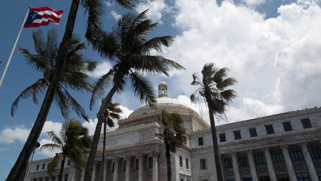 FILE PHOTO: The flag of Puerto Rico flies outside the Capitol building in San Juan