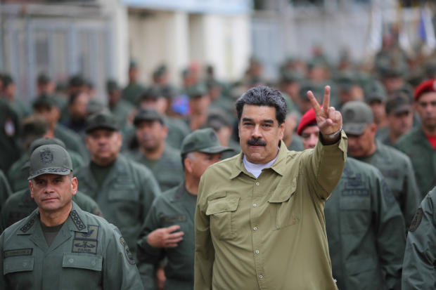 Venezuela's President Nicolas Maduro gestures during a meeting with soldiers at a military base in Caracas