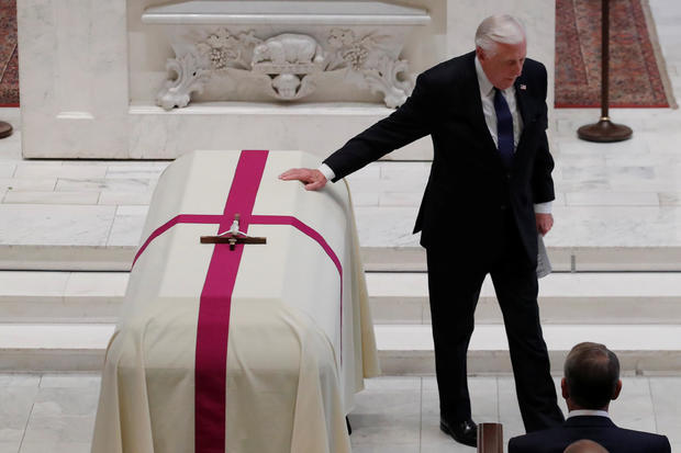 U.S. Rep. Hoyer touches casket during funeral Mass for late U.S. Rep. Dingell at Holy Trinity Church in Washington