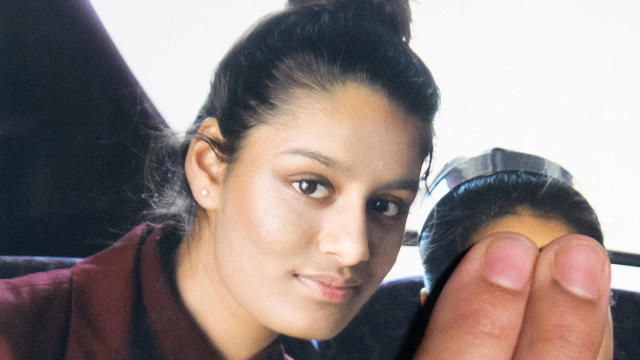 Shamima Begum is seen in a photo held by her sister Renu Begum at Scotland Yard in London Feb. 22, 2015.
