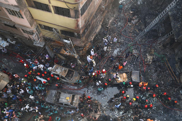 General view outside the burnt warehouse at Chawkbazar in Dhaka