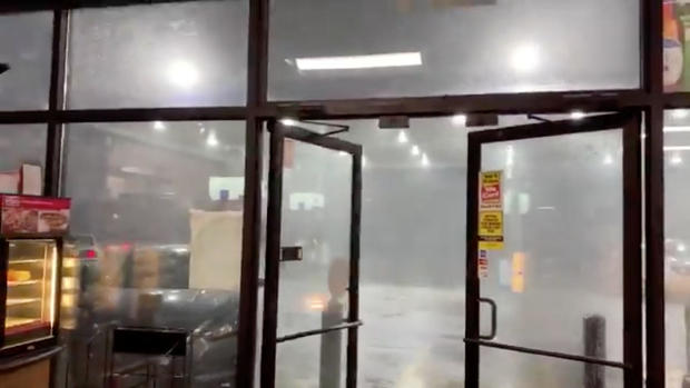 Winds and rain are seen near where a tornado hit, in Columbus, Mississippi