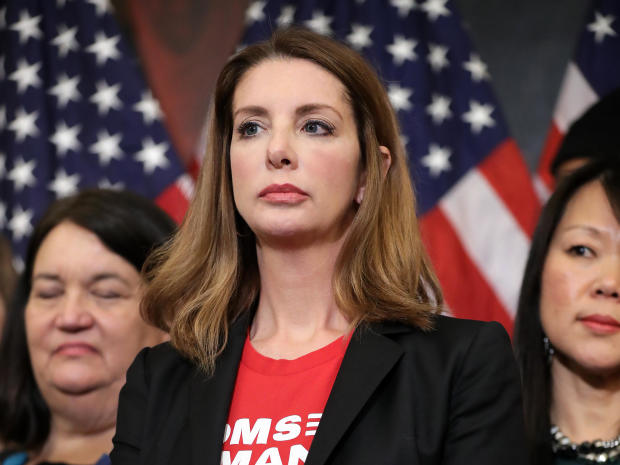 Moms Demand Action for Gun Sense founder Shannon Watts joins other gun-safety advocates for a news conference to introduce legislation to expand background checks for firearm sales in the Rayburn Room of the U.S. Capitol Jan. 8, 2019, in Washington.