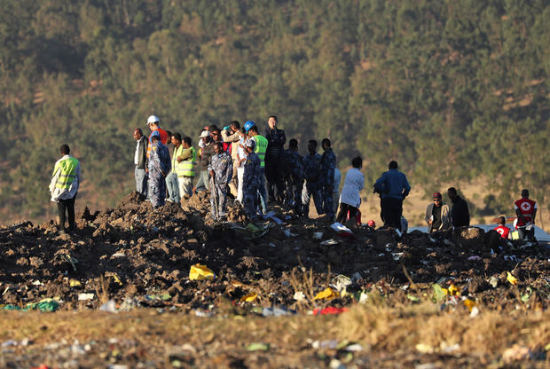 Members of the search and rescue mission look for dead bodies of passengers at the scene of the Ethiopian Airlines Flight ET 302 plane crash, near the town of Bishoftu