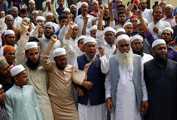 Muslims shout slogans as they condemn the Christchurch mosque attack in New Zealand, after Friday prayers at the Baitul Mukarram National Mosque in Dhaka